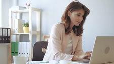 Woman Entrepreneur Working at Laptop