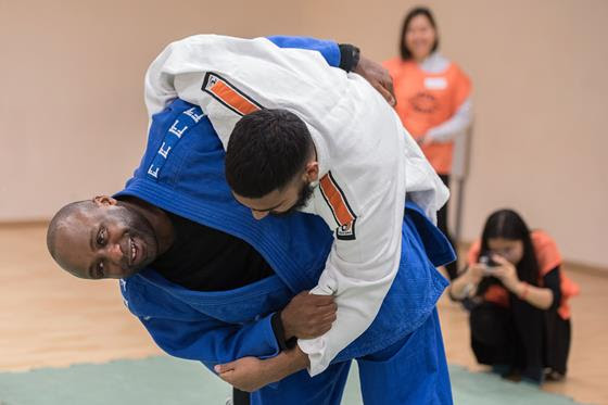 Two visually impaired judo players in a match