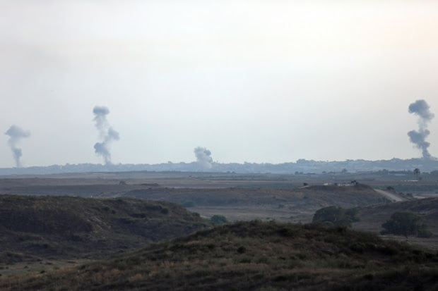 Smoke rises following Israeli strikes on Gaza, seen from the Israel-Gaza border.