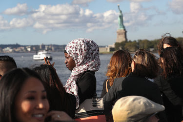Immigrants on their way to Ellis Island in New York for a naturalization ceremony last week.