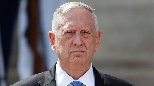 Defense Secretary Jim Mattis waits to greet Polish Defense Minister Antoni Macierewicz, upon his arrival at the Pentagon, Thursday, Sept. 21, 2017, in Washington. (AP Photo/Alex Brandon)
