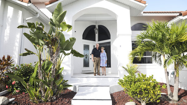 John and Mary Jane Forr stand outside their home in Punta Gorda, Fla. Forr, a retired Marine Corps colonel, discovered he could save $2,500 a year by shopping around for a lower-rate mortgage.Tricks to improve your credit score.