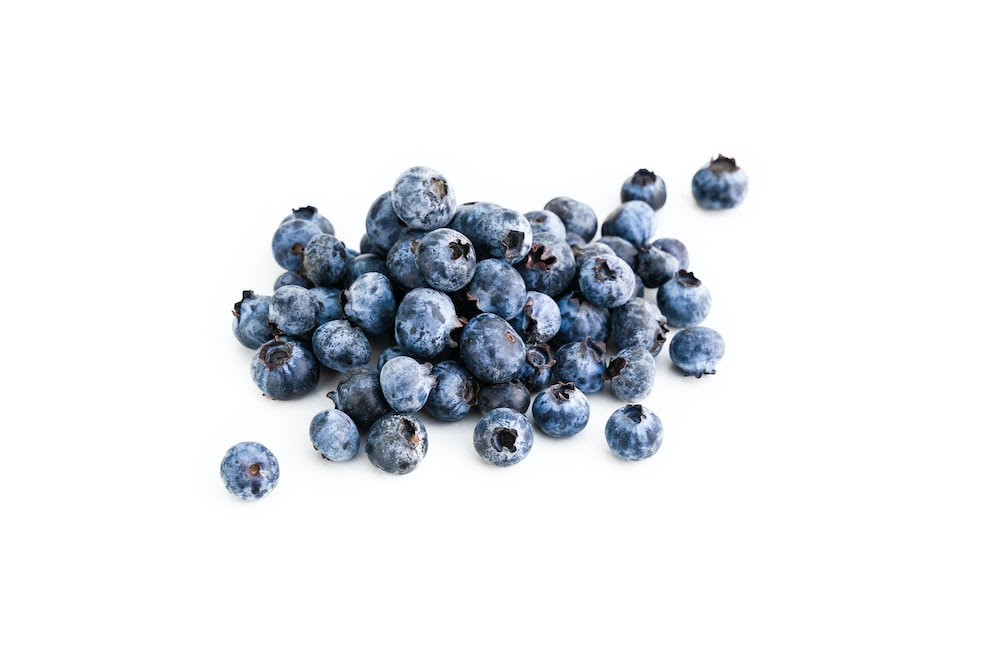 blue and white round fruits