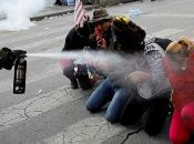 Demonstrators are pepper sprayed by a member of the security forces during clashes between supporters of former Bolivian President Evo Morales and the security forces, in La Paz, Bolivia November 15, 2019.