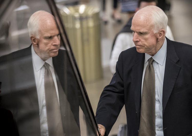 John McCain arrives at the Capitol last month for a briefing on the health-care bill. (J. Scott Applewhite/AP)