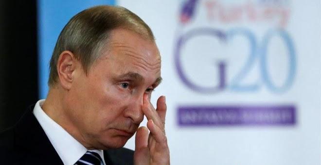 El presidente ruso, Vladímir Putin, durante una rueda de prensa con motivo de la décima cumbre del G-20 celebrada en Turquía. EFE/Yuri Kochetkov