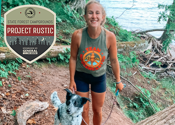 Paige posing with her dog with water in background, Project Rustic logo