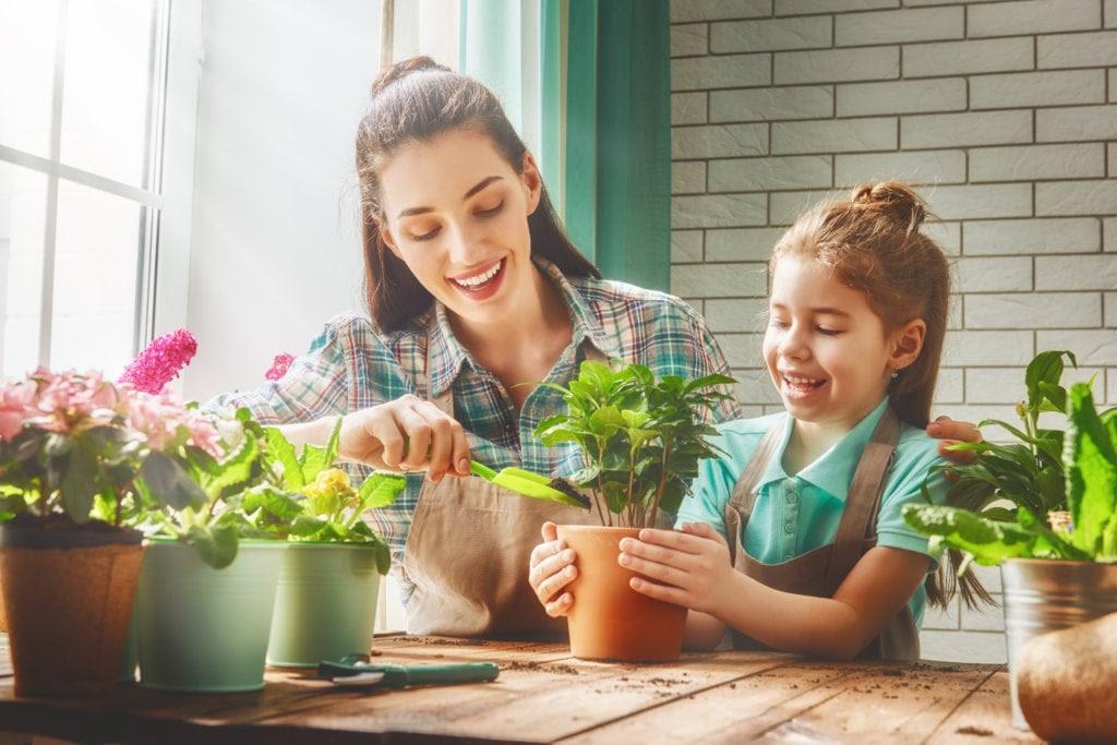 kids planting vegetables in pots
