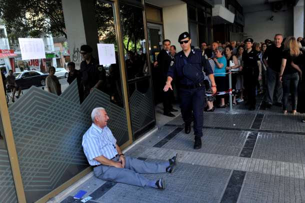 -- AFP PICTURES OF THE YEAR 2015 -- Giorgos Chatzifotiadis, an elderly man, cries outside a national bank branch in Thessaloniki on 3 July, 2015 as pensioners queue to draw their pensions, up to a limit of 120 euros. Greece is almost evenly split over a crucial weekend referendum that could decide its financial fate, with a 'Yes' result possibly ahead by a whisker, the latest survey Friday showed. Prime Minister Alexis Tsipras's government is asking Greece's voters to vote 'No' to a technically phrased question asking if they are willing to accept more tough austerity conditions from international creditors in exchange for bailout funds. AFP PHOTO /Sakis Mitrolidis