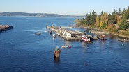Pontoons being towed by tugboats on Lake Washington