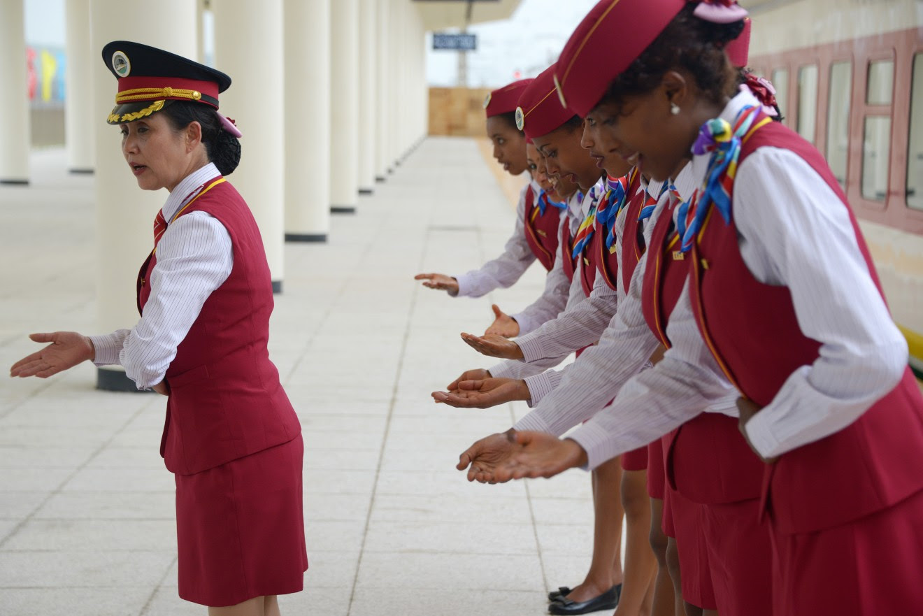 A Chinese rail conductor trains Ethiopian attendants at a railway station in Ethiopia in 2016. China built a railway linking the Ethiopian capital of Addis Ababa and the port of Djibouti as part of the Belt and Road Initiative.