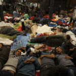 syrian_refugees_having_rest_at_the_floor_of_keleti_railway_station-_refugee_crisis-_budapest_hungary_central_europe_5_septemb