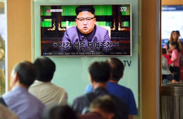"""South Koreans at a rail station in Seoul watched Kim Jong-un, the North Korean leader, deliver a statement last week. Mr. Kim called President Trump """"deranged."""""""