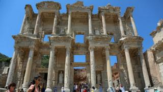 Tourists visit the Celsius Library in the ancient city of Ephesus near Izmir in the western Aegean region, Turkey