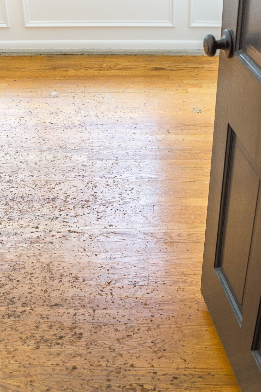 A step-by-step tutorial for refinishing an existing hardwood floor, including a complete list of materials and tips for a seamless process.