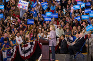 Hillary Clinton with the billionaire investor Warren Buffett at a campaign event in Omaha on Monday.