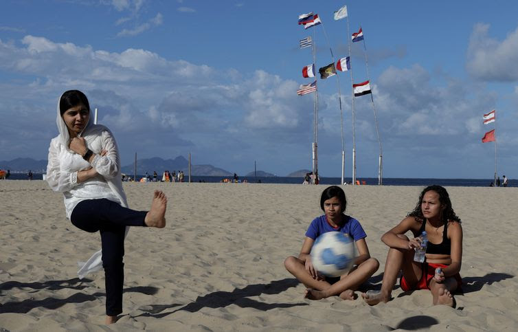 Nobel prize winner Malala Yousafzai plays a penalty kick during a meeting with teenage girls from Complexo da Penha who work with football organization Street Child United at Copacabana beach in Rio de Janeiro, Brazil July 11, 2018. REUTERS
