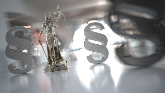 Image of Lady Justice with Paragraph Symbols