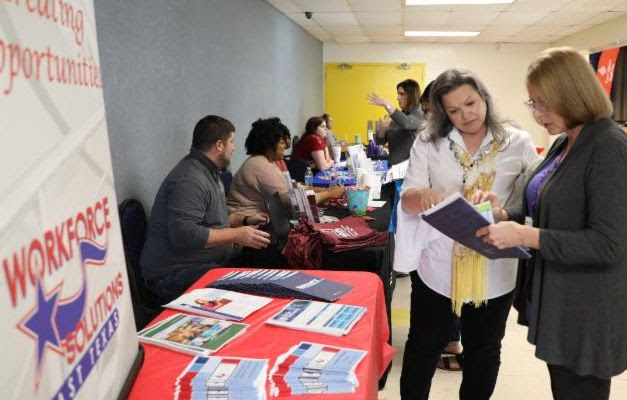 Student HireAbility Navigator, Sonia White, at a community event assisting a visitor with program information.