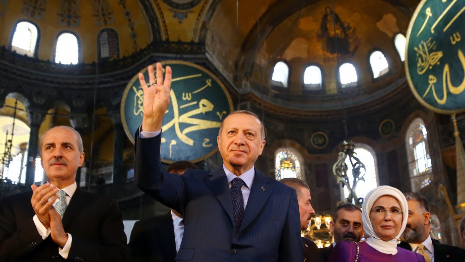 Turkish President Recep Tayyip Erdoğan, accompanied by his wife Emine Erdoğan, attends the opening ceremony of the Yeditepe Biennial at the Haghia Sophia Museum in Istanbul, Turkey, March 31, 2018.
