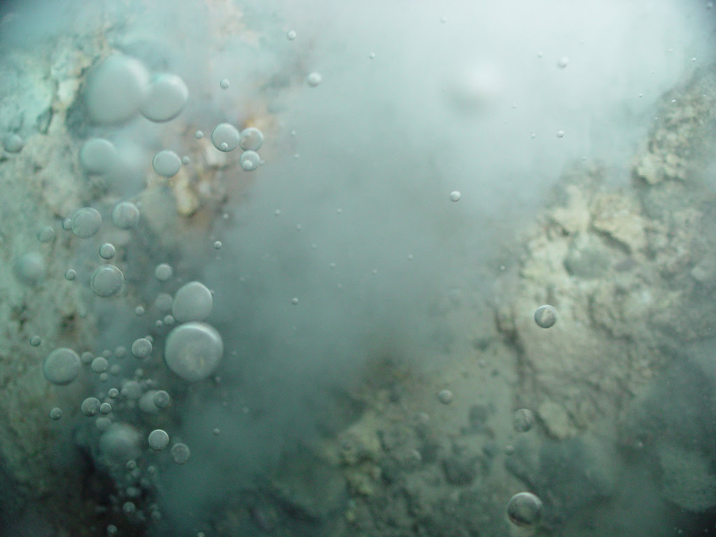 Bubbles of liquid CO2 float out of the seafloor at Champagne vent in the Mariana Arc region. Photo courtesy of Pacific Ring of Fire 2004 Expedition. NOAA Office of Ocean Exploration; Dr. Bob Embley, NOAA PMEL, Chief Scientist.
