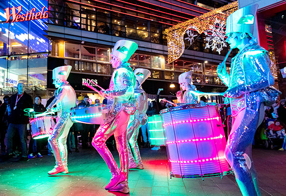 LED drummers at night.