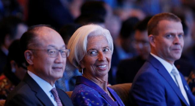 El presidente del Banco Mundial,  Jim Yong Kim; Christine Lagarde, al frente del FMI; y el ministro finlandés de finanzas, Petteri Orpo, en un evento esta semana