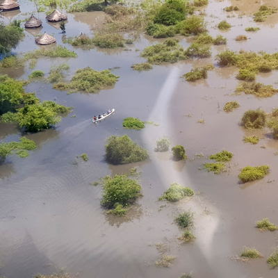 On an aerial assessment from Gumuruk to Lekongole, where MSF runs two primary healthcare units, people can be seen moving via canoes as their tukuls are completely submerged.