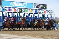 Winner Vino Rosso breaks from the far outside post 9 in the Wood Memorial at Aqueduct Racetrack