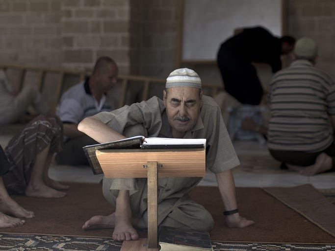 A Palestinian man reads the Quran in the Sayed al-Hashim Mosque in Gaza City.