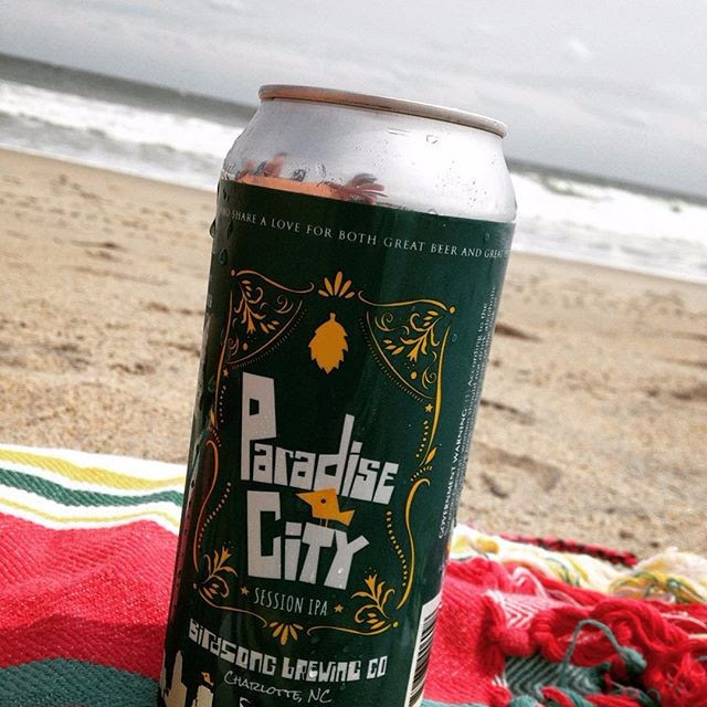 @the_mrs_avocado and Paradise City chillin' on the beach this summer