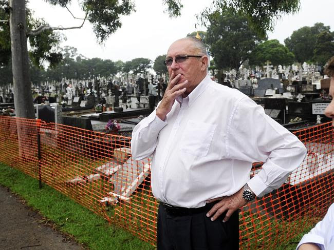 Ian McIntosh, CEO of the Rookwood Necropolis Trust, inspects the damage. Picture: Phillip