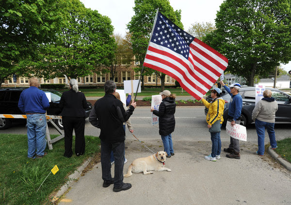 A group protesting outside the St. Joseph, Mich., office of Representative Fred Upton on Wednesday. Mr. Upton has emerged as a crucial supporter of the latest effort to revive the G.O.P.'s health care bill.