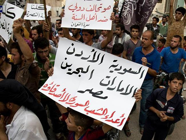 Blurred lines ... An anti-Assad activist group protests against the US-led airstrikes in