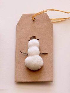 Three White Pom-Poms = Snowman Gift Tag | 51 Seriously Adorable Gift Tag Ideas