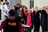 People evacuating the Crabtree Valley Mall in Raleigh, N.C., on Aug. 13 after loud sounds, still unexplained, were mistaken for gunshots.