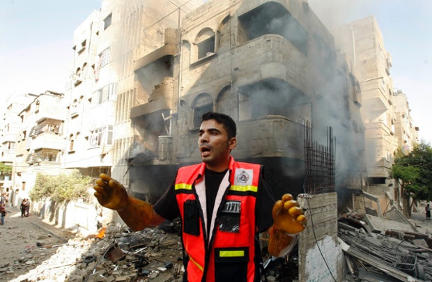 A member of the civil defence reacts after what police said was an Israeli air strike on a house.