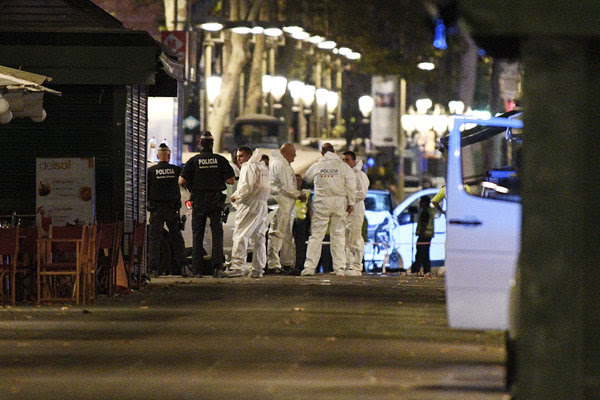 Police officers on Las Ramblas in Barcelona, Spain, on Thursday night, hours after an attacker driving a van killed more than a dozen people.