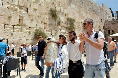 Bar Mitzvah boy carries Torah                 scroll at the Kotel