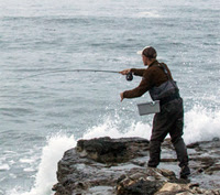 Flyfishing guide Jack Harrison casting into the surf.
