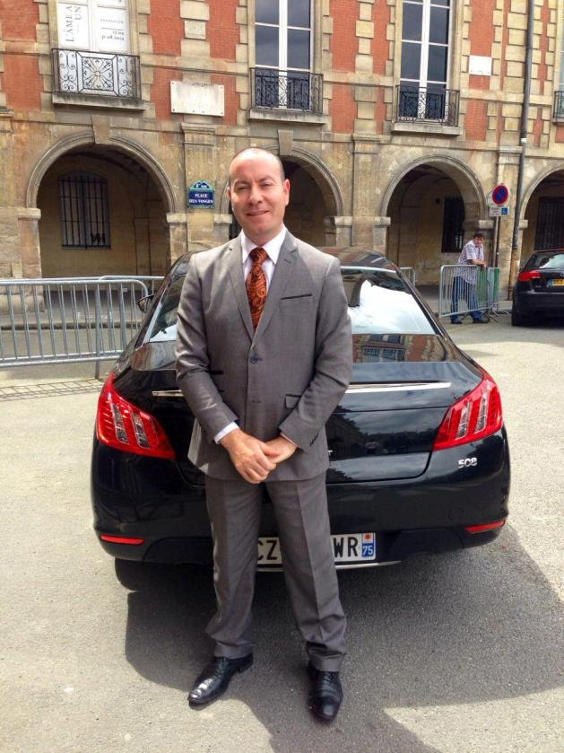 Mohamed in front of his car in Paris.jpg