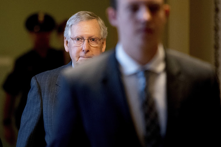 Senate Majority Leader Mitch McConnell (R-Ky.) arrives at the Capitol. (Andrew Harnik/AP)</p>