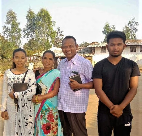 Vijay Kumar Pusuru with family members, whose home in Odisha state, India, was demolished along with his school. (Morning Star News)