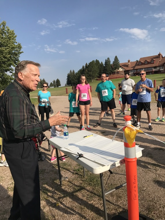 Dr. Hales talks to the runners before they begin their race at the Hereford Ranch.