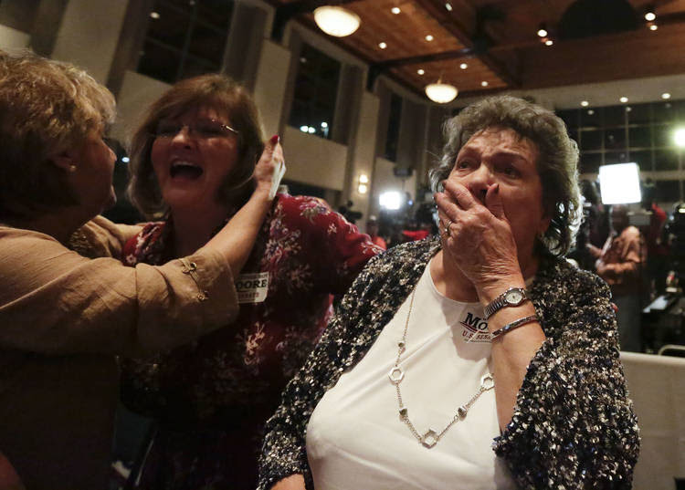 Evelyn Ridgeway, right, Roy Moore's mother, cries after hearing her son won during his election party in Montgomery, Ala. (Brynn Anderson/Associated Press)