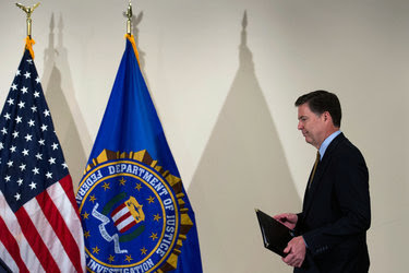 James B. Comey during a news conference on Tuesday.