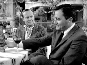 Solo verbally jousts with Harold Bufferton (John Van Dreelen) in The Giuoco Piano Affair