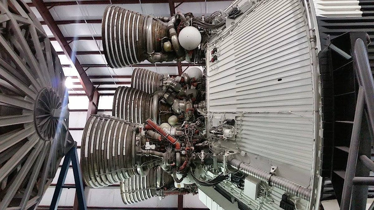 The five J-2 engines (shown below) burned two-thirds as much fuel as the first stage and produced 1 million pounds of thrust (about one-seventh as much as the first stage).
