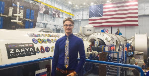 Spaceflight Operations senior Nicholas Lopac stands in the Vehicle Mockup Building, where astronauts train for new vehicles and the International Space Station, during a recent internship at NASA.