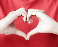image of person making heart shape with hands
